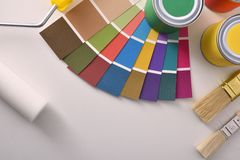Tools for painting houses on white table top view stock images