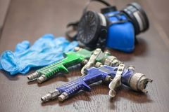 Tools for painting. Respirator, gloves, spray gun royalty free stock images