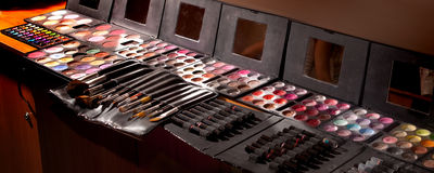 Tools and paints for make-up, pallets with shadows and brushes Stock Image