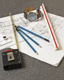 Tools and papers with sketches. On the table Royalty Free Stock Images