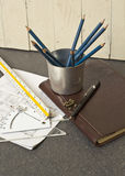 Tools and papers with sketches. On the table Stock Image