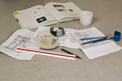 Tools and papers with sketches. On the table Royalty Free Stock Photography