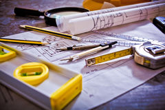 Tools and papers with sketches. Architectural design and project blueprints drawings royalty free stock photography