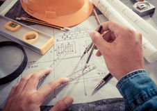 Tools and papers with sketches. Architectural design and project blueprints drawings stock images