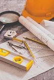 Tools and papers with sketches. Architectural design and project blueprints drawings-Filtered Image stock photo