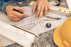 Tools and papers with sketches. Architectural design and project blueprints drawings-Filtered Image stock photos