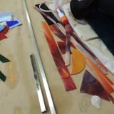 Tools and parts for a stained glass project. Tools and parts on table used to create stained glass artwork Stock Photo