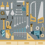 Tools on peg board. Set of tools hanging on peg board wall with shelf and drawers Royalty Free Stock Images