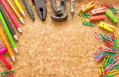 Tools, pencil and paperclips on old paper background Stock Photography