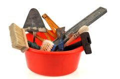 Tools in a plastic basin on a white background royalty free stock photos