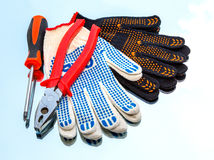Tools, pliers, a screwdriver, a protection glove Stock Photography