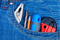 Tools in pocket jeans. Royalty Free Stock Photo