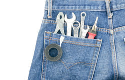 Tools in pocket jeans isolated Stock Image