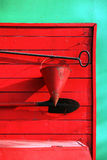 Tools for precaution. Bucket, a shovel, a breakage against an old wooden red shed Stock Photo