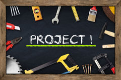 Tools project chalkboard. Tools on project blackboard with wooden frame stock photo