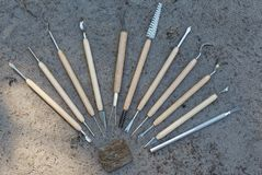 Tools for qualitative cleaning of finds in archeology. Different tools for qualitative cleaning of finds in archeology, paleontology and geology Stock Image