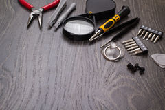 Tools for repair of electronics. On a table Royalty Free Stock Images