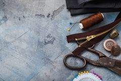 Tools for repair and tailoring on right side of the table. With copy space royalty free stock photo