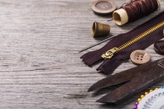 Tools for repair and tailoring on right side of wooden table. With copy space royalty free stock image