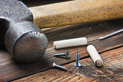 Tools for repairing lie on a wooden table Stock Image
