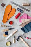 Tools for repairing shoes on grey stone desk background top view Stock Images