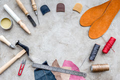 Tools for repairing shoes on grey stone desk background top view space for text Royalty Free Stock Images