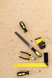 Tools for repairing top view on pasteboard background Royalty Free Stock Images