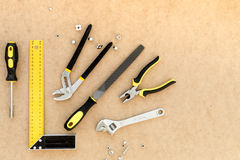 Tools for repairing top view on pasteboard background.  Stock Images