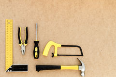 Tools for repairing top view on pasteboard background Royalty Free Stock Image