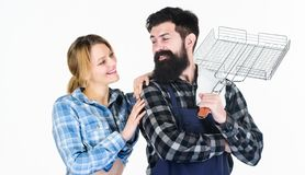 Tools for roasting meat. Man bearded hipster and girl. Preparation and culinary. Family weekend. Couple in love hold stock images