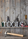 Tools Rustic Wood Background. The word tools with lots of tools on a wood background Royalty Free Stock Images
