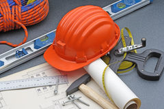 Project architecture with plan, helmet and useful tools. stock photography
