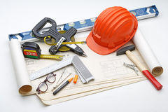 Project plan with helmet and tools constructions royalty free stock image