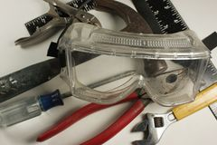 Tools and safety goggles Stock Photography