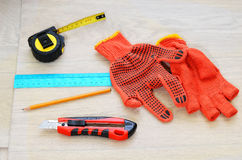 Tools scattered on the floor. Tape-measure royalty free stock image