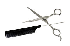 Tools. Scissors and comb on a white background stock image
