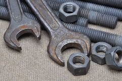 Tools screws nuts and key Stock Photography