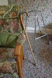 Tools of Seniority. Chair, walking stick and zimmer walking frame Royalty Free Stock Photos