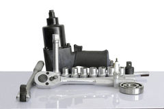 Tools set. Pneumatic wrench, drive socket set, ball bearing, on over white, and reflections Royalty Free Stock Photo