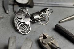 Tools set of jewellery. Jewelry workplace on metal background. Finger sizing for rings, beam compass, pincer, nippers Stock Photos