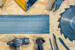Tools set on osb panel with copy space. Carpenter workplace on wooden background. Top view.  royalty free stock image
