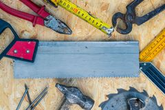 Tools set on osb panel with copy space. Carpenter workplace on wooden background. Top view.  royalty free stock images
