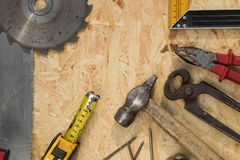 Tools set on osb panel with copy space. Carpenter workplace on wooden background. Top view.  stock image