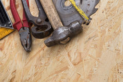 Tools set on osb panel with copy space.  Carpenter workplace on Stock Images
