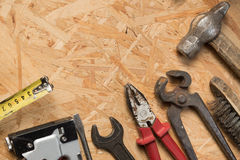 Tools set on osb panel with copy space.  Carpenter workplace on Royalty Free Stock Photography