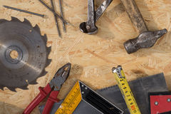 Tools set on osb panel with copy space.  Carpenter workplace on Stock Photography
