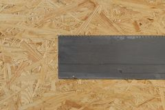 Tools set on osb panel with copy space. Carpenter workplace on wooden background. Top view.  stock images