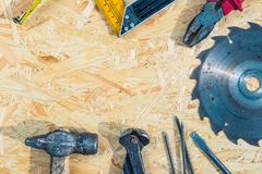 Tools set on osb panel with copy space. Carpenter workplace on wooden background. Top view.  royalty free stock photo