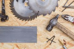 Tools set on osb panel with copy space. Carpenter workplace on wooden background. Top view.  royalty free stock photography
