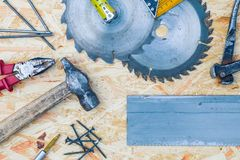 Tools set on osb panel with copy space. Carpenter workplace on wooden background. Top view.  stock photo